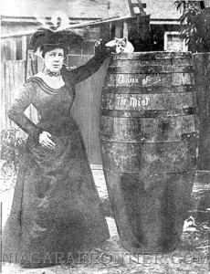 ADVANCE FOR SUNDAY, JUNE 25--Michigan schoolteacher Annie Taylor, at age 43, poses with her famous barrel in this undated file photo. Taylor went over Niagara Falls in the oak barrel on Oct. 24, 1901. (AP Photo/Buffalo News, file)